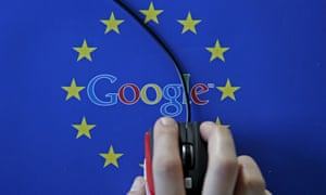 a hand hovers over a mouse mat with Google imprinted over the EU flag