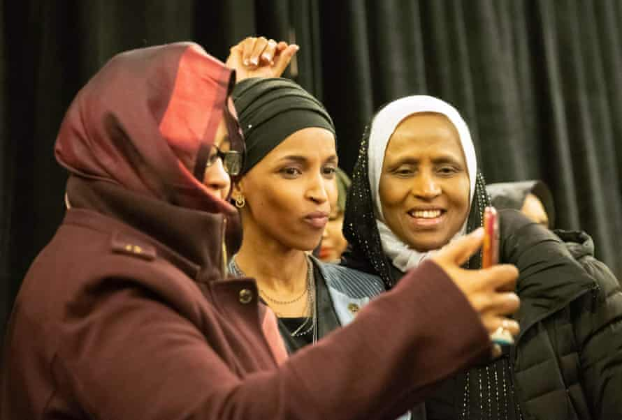 The Democrat politician takes a selfie with supporters.
