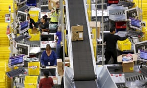 Workers prepare orders for customers at the Amazon fulfillment center in Tracy, California.