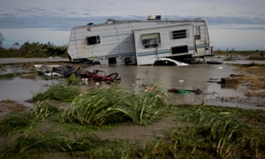 A damaged travel trailer sits among flood water after Hurricane Laura passed through the area August 27, 2020 in Holly Beach, Louisiana.
