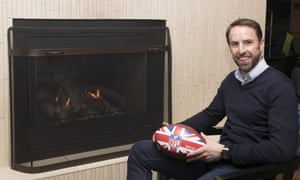 Gareth Southgate warms himself by the fire