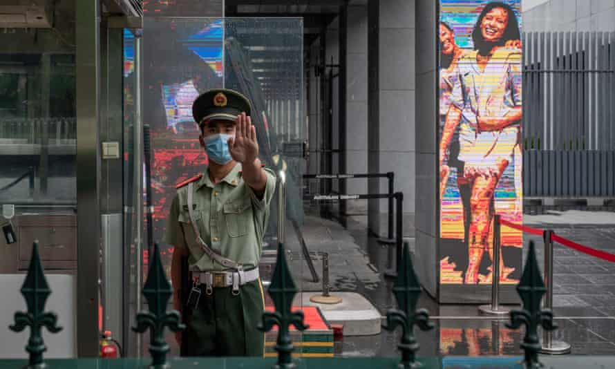 A Chinese paramilitary police stands at the entrance of the Australian embassy in Beijing in July.