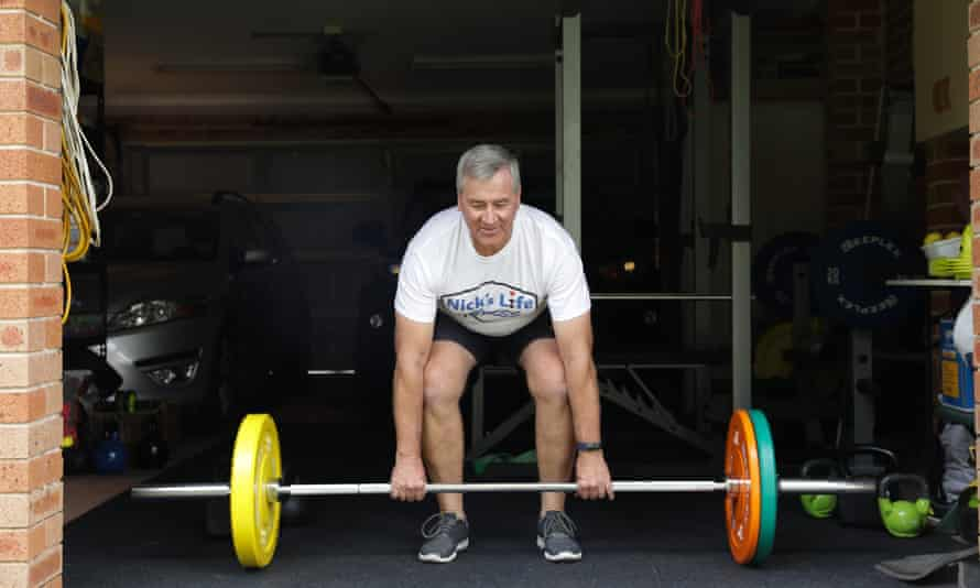 Nick Fowler, an electrical engineer turned personal trainer, works out in his Hawkesbury, NSW, garage