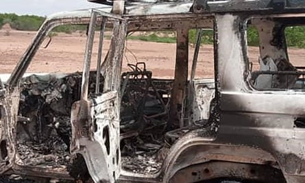 The remains of a car after the attack by gunman on motorcycles.