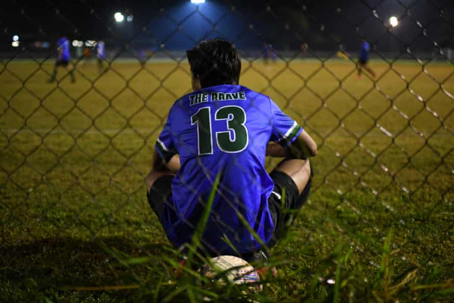 A member of QR The Brave FC watches his team.