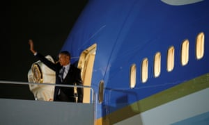 Barack Obama waves as he departs Joint Base Andrews in Washington on his way to Athens.