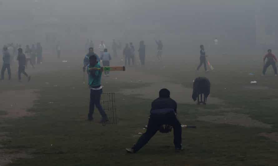 Children playing cricket in Lahore. At times in recent weeks, Lahore's levels of PM 2.5 were more than 30 times the WHO's safe limit.