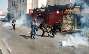 Teargas among people in street