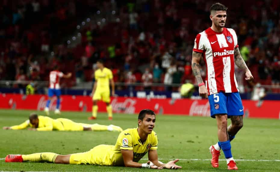 Aïssa Mandi lies on the floor after scoring a late own goal in the La Liga draw between Villarreal and Atlético Madrid.