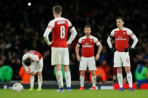 Mesut Ozil dejected after that third goal.