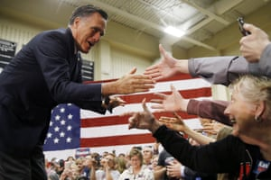 Mitt Romney meets with attendees at a Republican presidential candidate John Kasich campaign stop.