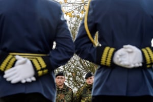 German Nato soldiers and members of the Kosovo Security Force stand guard at a Remembrance Day ceremony at the Orthodox cemetery in Pristina