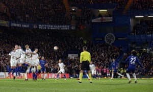 Willian whips his free-kick over the wall and into the top corner.