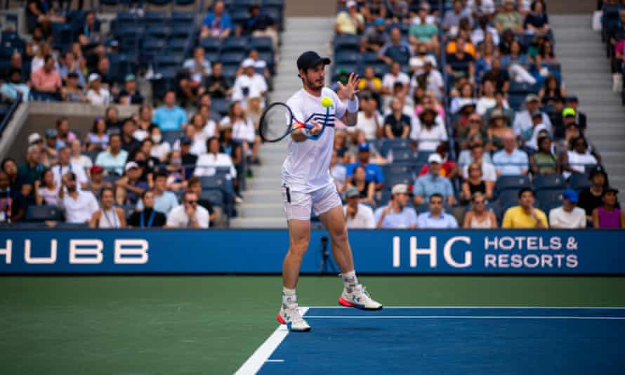 Andy Murray rises to hit a forehand during his match with Stefanos Tsitsipas at the US Open.