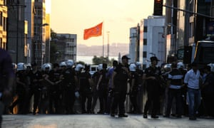 Riot police form a line