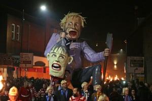 An effigy of Boris Johnson carrying the head of Theresa May