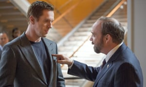 Damian Lewis as Bobby 'Axe' Axelrod and Paul Giamatti as Chuck Rhoades in Billions.