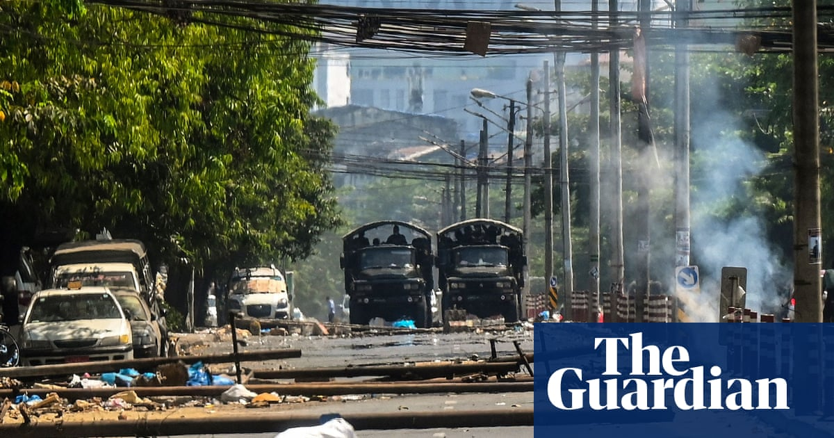 Myanmar police surround protesters and raid compound in Yangon