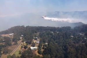 Queensland Fire and Emergency Services drop water over bushfires in Binna Burra.
