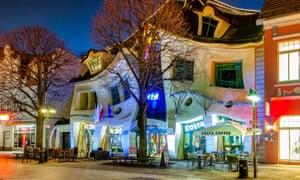 The Crooked House, illuminated shopfront at night, on Bohaterów Monte Cassino, Sopot, Poland