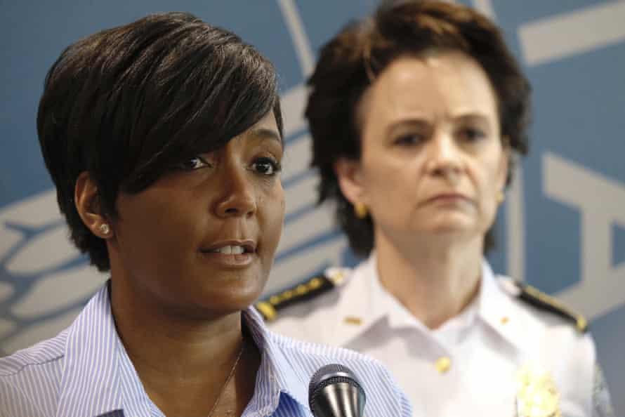 Georgia's governor, Brian Kemp, sued Atlanta's mayor, Keisha Lance Bottoms, above left, over a mask mandate.