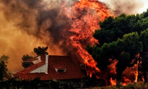 A house is threatened by a huge blaze in Kineta. Strong winds have exacerbated the blazes
