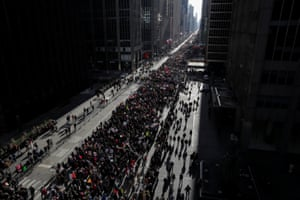 People walk down Sixth Avenue as they participate in the Women's March in Manhattan, New York City