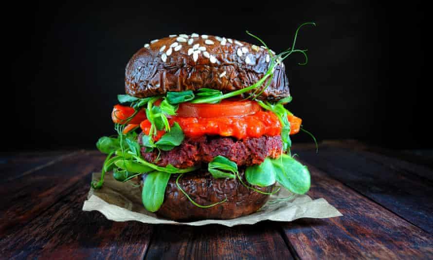 Portobello bun mushroom vegan burger on a wooden board