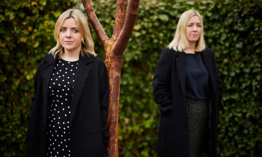 Rebecca Jones and her sister, Jenny Davies, standing by tree.
