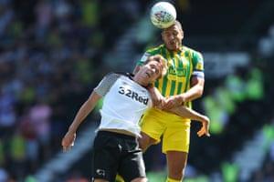 Jake Livermore rises above Derby's Kieran Dowell.