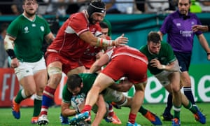 Ireland's lock Iain Henderson (down) is tackled during the World Cup pool match against Russia.
