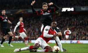 Danny Welbeck wins a penalty for Arsenal against Milan