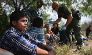 Border patrol agents detain people crossing into the US in Roma, Texas.
