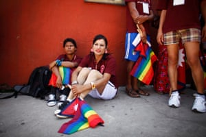 Member of the LGBT community hold the gay pride flag during the opening ceremony of the 1st South Asian LGBT Games organized by Blue Diamond Society in Katmandu, Nepal, in 2012