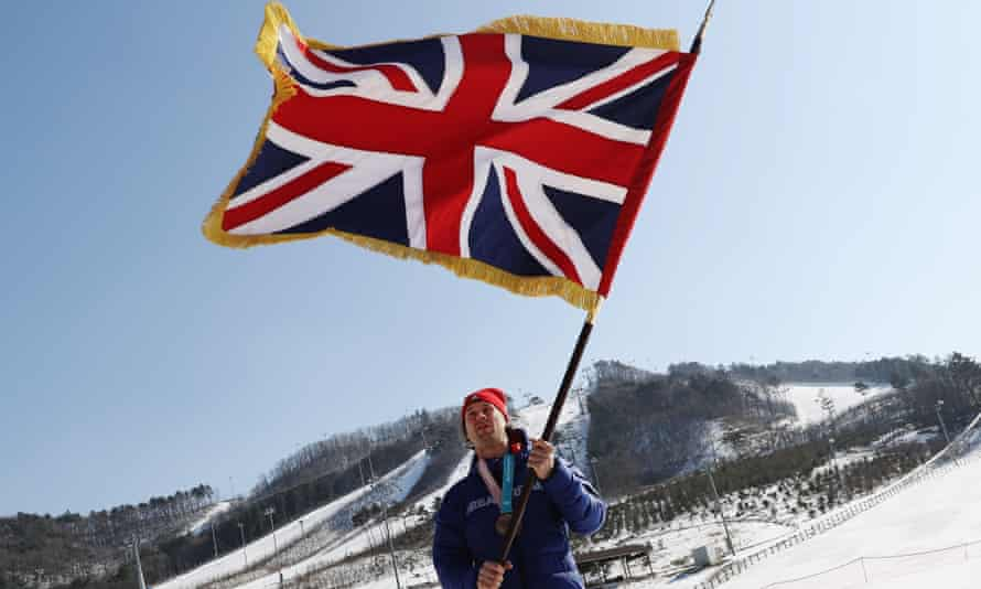 Flying the flag: Billy Morgan celebrates at the end of the Winter Olympics in Pyeongchang where he was one of five medallists for Team GB.