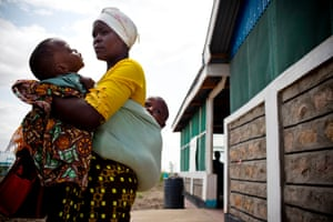 Frank, who has cerebal palsy, with her mother in Kakuma refugee camp, in northern Kenya