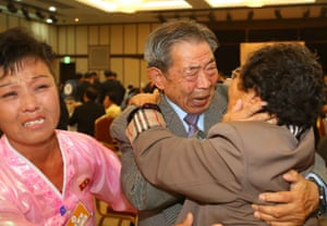 Min Ho-sik (centre), 84, hugs his North Korean relative Min Eun-Sik (right), 81. The reunion is the 20th to take place since 2000