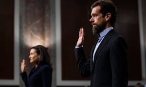 CEO of Twitter Jack Dorsey, right, and COO of Facebook Sheryl Sandberg are sworn-in before testifying at a Senate Intelligence Committee hearing on Wednesday.