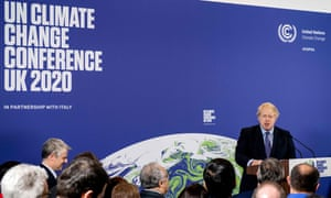 Boris Johnson speaking in front of screen reading: 'UN Climate Change Conference UK 2020'