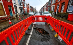 A sink hole that has appeared in a residential street in Aigburth, Liverpool
