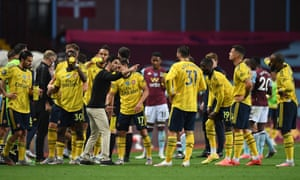 Mikel Arteta talks to his players in a drinks break during the match against Aston Villa.