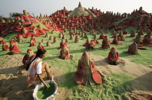 Some of the 500 sculptures of Father Christmas created by students of the sand artist Sudarshan Pattnaik on the beach at Puri.