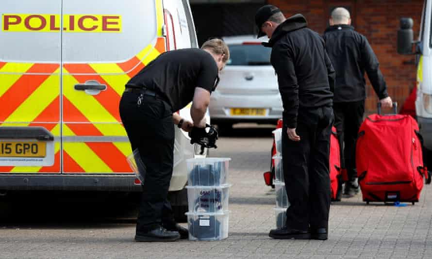 Police officers prepare equipment as OPCW inspectors arrive in Salisbury.