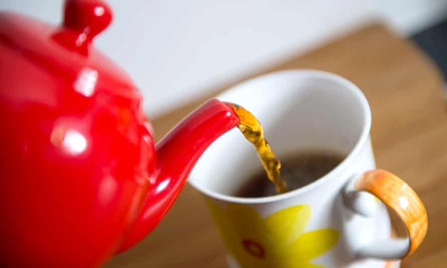 Tea being poured into cup