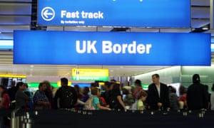 Passengers going through the UK Border at Terminal 2 of Heathrow Airport