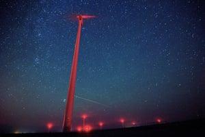Meteors illuminate the sky over a wind turbine at St Nikola windfarm in Kavarna, Bulgaria