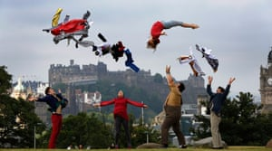 The Hogwallops from the Lost in Translation Circus at the Underbelly Circus Hub propel cast member Roisin Morris into the air on the city side of Calton Hill