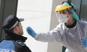 A health worker takes a swab in Madrid. Photograph: Rafa Albarran/Madrid City Hall/AFP via Getty Images