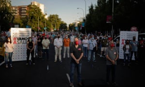 People stage a demonstration demanding a social structuring after the coronavirus pandemic following labour union's calls for protest in Madrid, Spain on June 27, 2020.