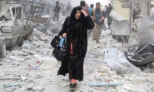A woman reacts as she walks amid debris of damaged buildings at a site hit by what activists said was an air strike from forces loyal to Syria's President Bashar al-Assad in Aleppo's al-Shaar district March 18, 2014. REUTERS/Hosam Katan (SYRIA - Tags: POLITICS CIVIL UNREST CONFLICT) - RTR3HMUO